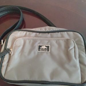 Small grey Roots crossbody purse.